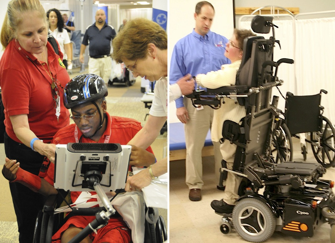 Two people are introduced to their new wheelchairs. A young man in shown how to work the touch screen attached to his wheelchair. A woman is shown how to bring her wheelchair into a standing position.